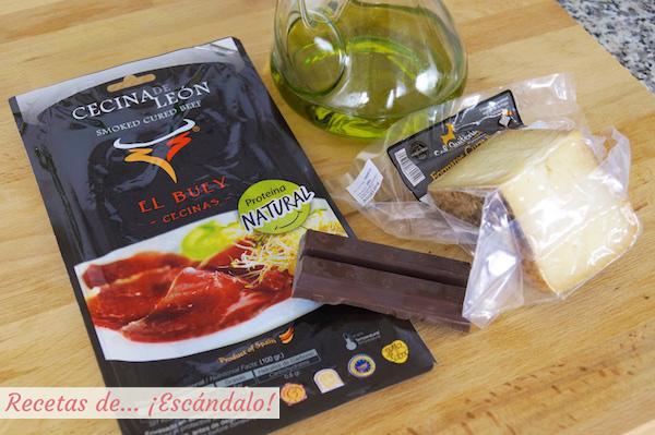 Ingredientes para preparar cecina de leon con chocolate, queso y aceite de oliva